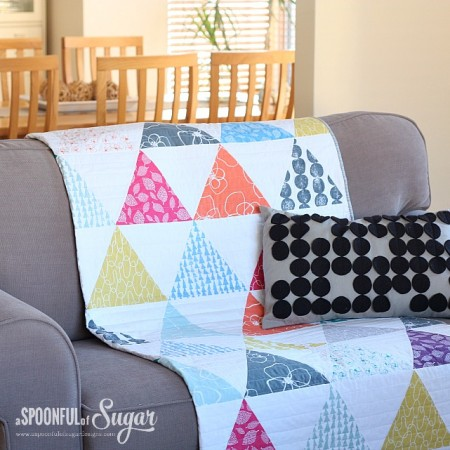 Mormor Triangle Quilt draped on sofa