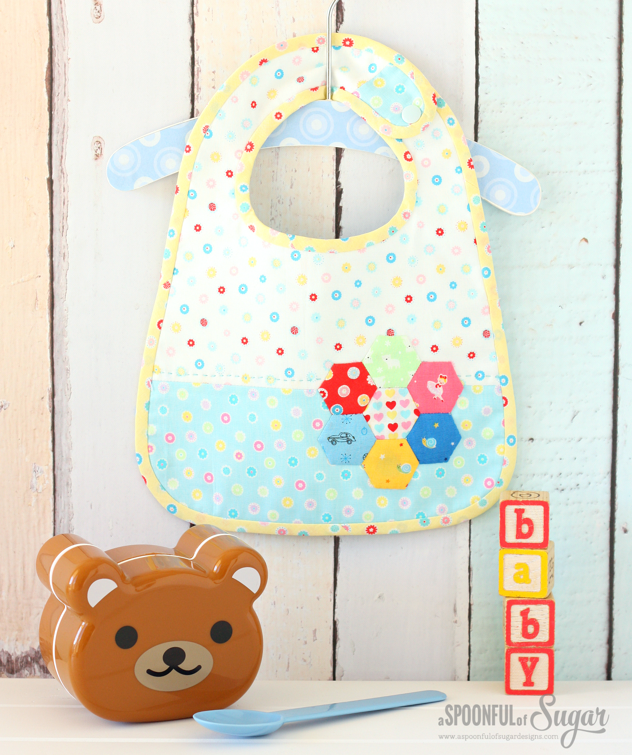 Hexagon Baby Bib from A Spoonful of Sugar, by Lisa Cox