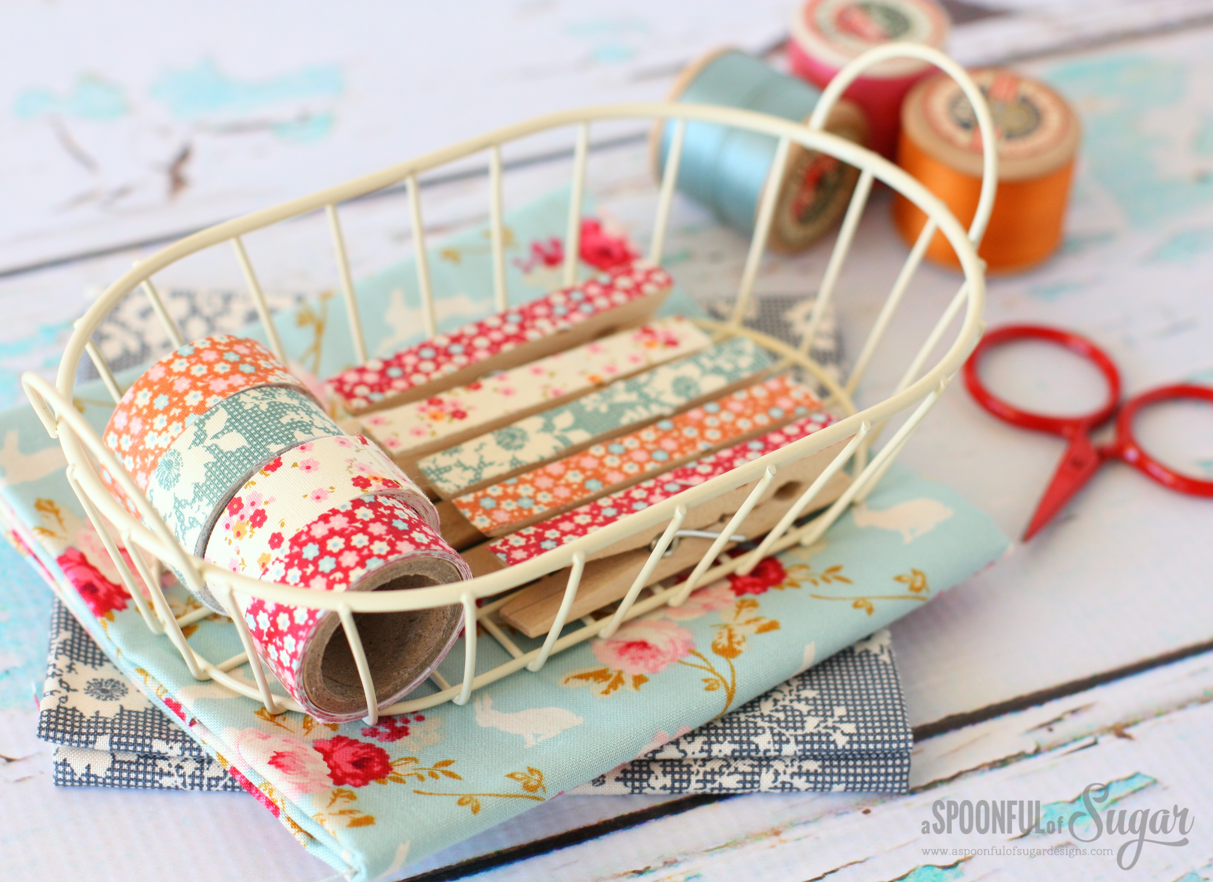 Decorate pegs (clothespins) with fabric tape