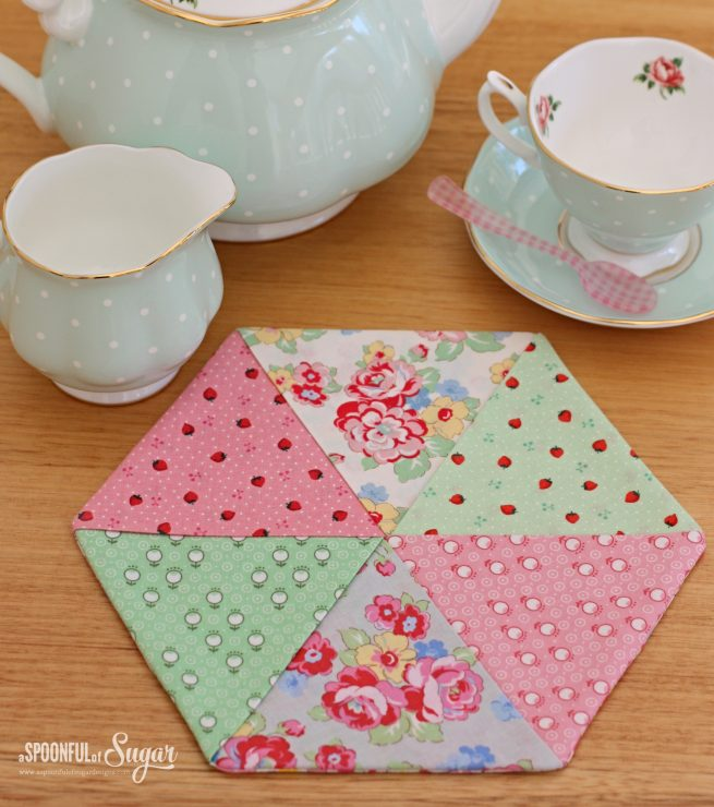 Floral placemat made using the Easy Hexagon Trivet and Coaster pattern by A Spoonful of Sugar.