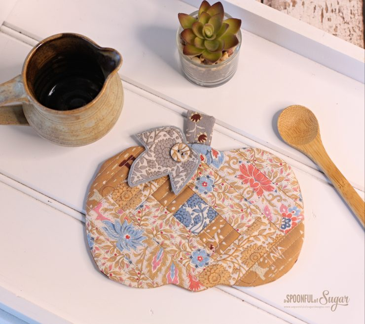Pumpkin Patchwork Coaster Mug Rug by A Spoonful of Sugar Designs. Pattern available in Pattern Store and in Etsy Shop. Fabric used is Tilda Windy Days.